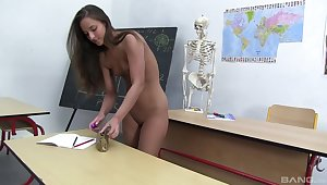 Schoolgirl rubs pussy naked while in the classroom
