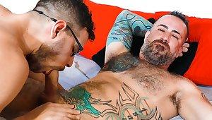 Beefy tattooed buddy pounding his friend