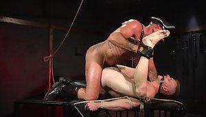 Gay slave endures rough anal in BDSM sex play
