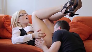 Nerdy blonde is exchanging oral pleasure with her man