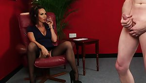 Clothed MILF watches beggar jerking off for her