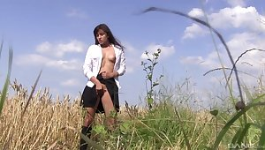 Busty solo girl enjoys the nature as her playing ground